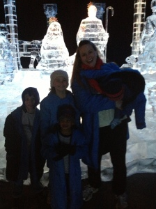 At the Ice! Exhibit with an amazing ice-sculpture life-sized nativity scene and a fussy baby!
